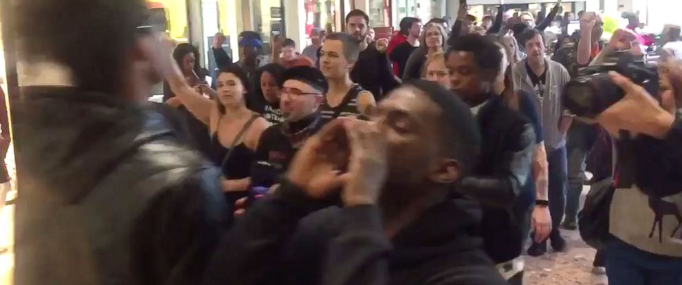 PHOTO: People chant in protest at the Galleria Mall, located near St.Louis, Missouri, Nov. 24, 2017.