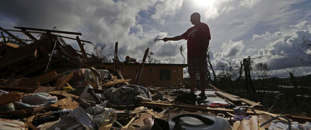 PHOTO: Jose Garcia Vicente holds a piece of plumbing he picked up, as he shows his destroyed home, in the aftermath of Hurricane Maria, in Aibonito, Puerto Rico, Sept. 25, 2017.