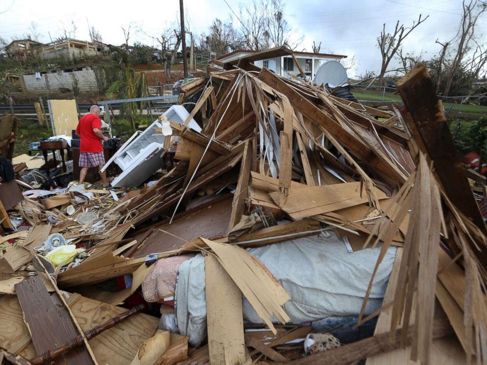PHOTO: Jose Garcia Vicente walks through rubble of his destroyed home, in the aftermath of Hurricane Maria, in Aibonito, Puerto Rico, Sept. 25, 2017.