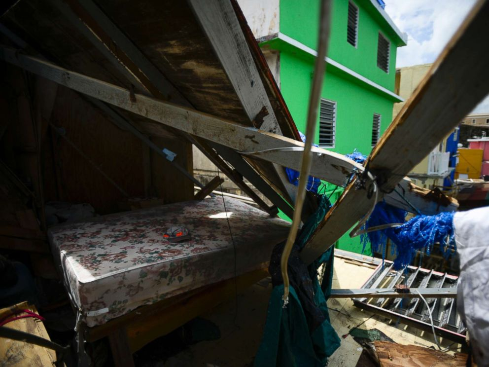PHOTO: A bed surrounded by debris after Hurricane Maria, in San Juan, Puerto Rico, Sept. 25, 2017.
