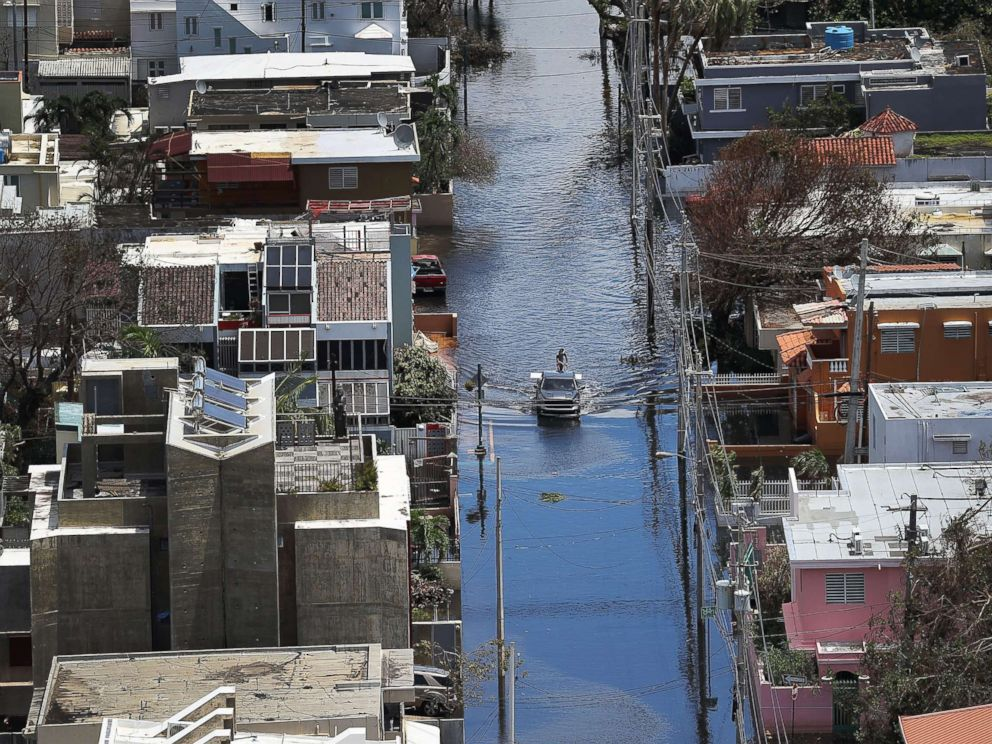 PHOTO: A flooded street is seen as people deal with the aftermath of Hurricane Maria on Sept. 25, 2017 in San Juan, Puerto Rico.