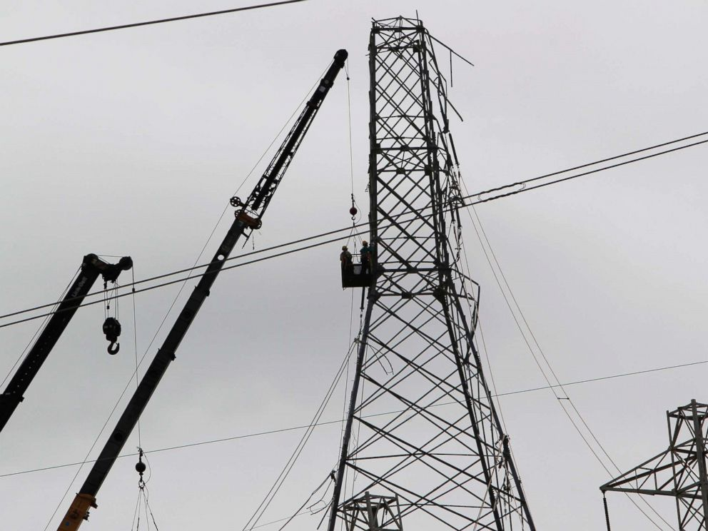 PHOTO: Workers restore high tension power lines damaged by Hurricane Maria in Guayama, Puerto Rico on Oct. 28, 2017.