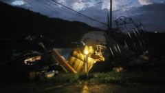 'PHOTO: A donated solar lamp in a driveway illuminates storm debris still waiting to be collected on Christmas day, Dec. 25, 2017, in Morovis, Puerto Rico.' from the web at 'http://a.abcnews.com/images/US/puerto-rico-dark-02-gty-jef-171229_16x9t_240.jpg'
