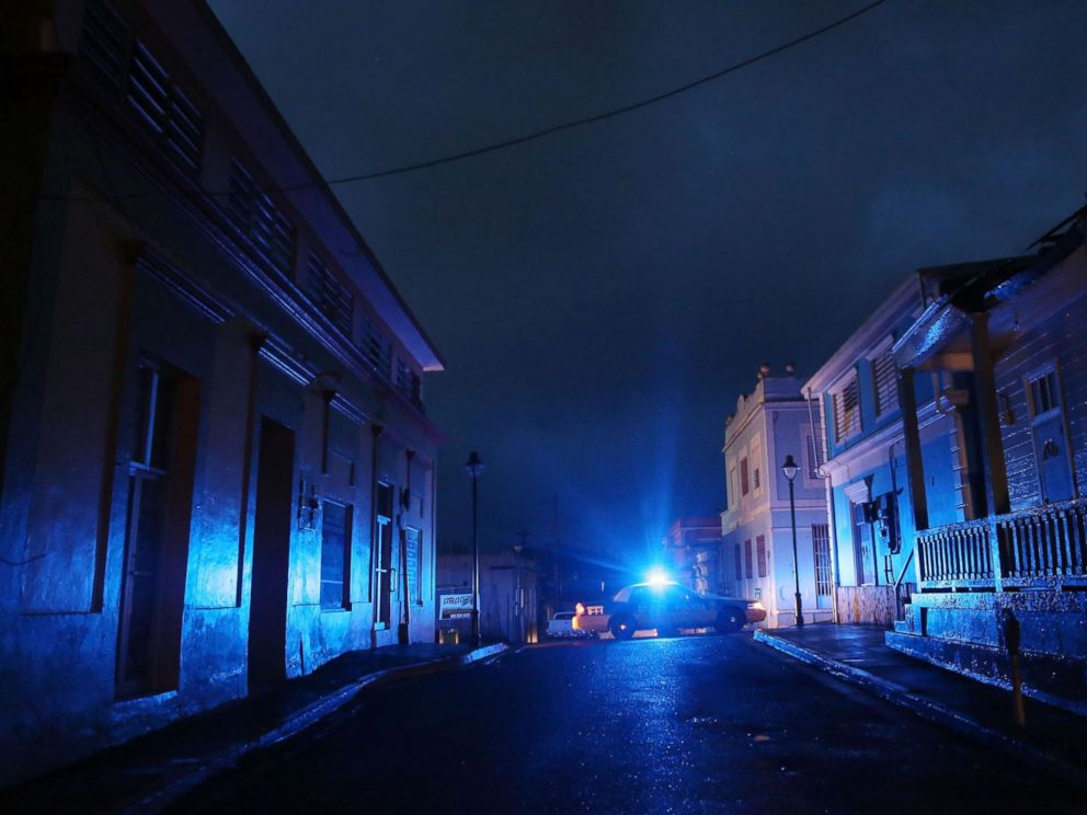 PHOTO: A police car patrols on a darkened street three weeks after Hurricane Maria hit the island, Oct. 11, 2017, in Aibonito, Puerto Rico.