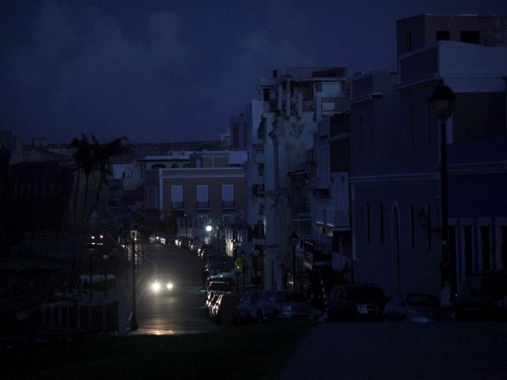 PHOTO: A car drives through a dark street in Old San Juan, Puerto Rico, Oct. 26, 2017, after Hurricane Maria hit the island and damaged the power grid in September.