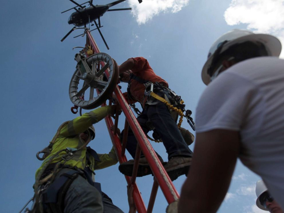 PHOTO: Workers from Montana-based Whitefish Energy Holdings help fix the islands power grid, damaged during Hurricane Maria in September, in Manati, Puerto Rico, Oct. 25, 2017.