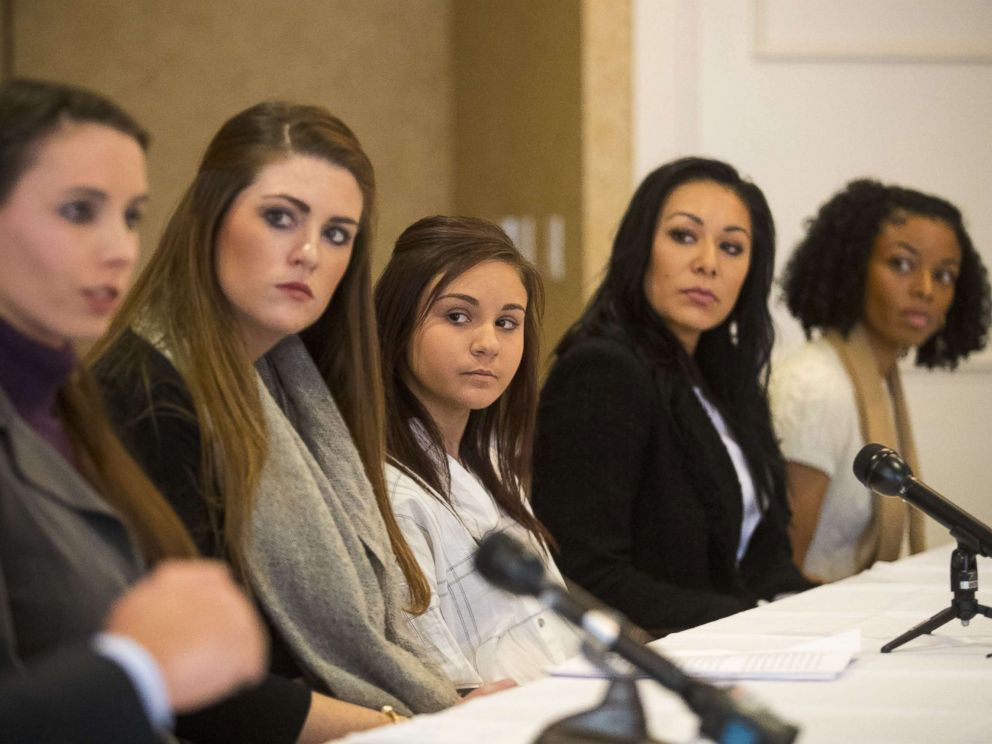 PHOTO: (L-) Rachael Denhollander, Sterling Riethman, Kaylee Lorincz, Jeanette Antolin and Tiffany Thomas appear at a press conference after Larry Nassar was sentenced to 60 years in prison on child pornography charges in Grand Rapids, Mich., Dec. 7, 2017.