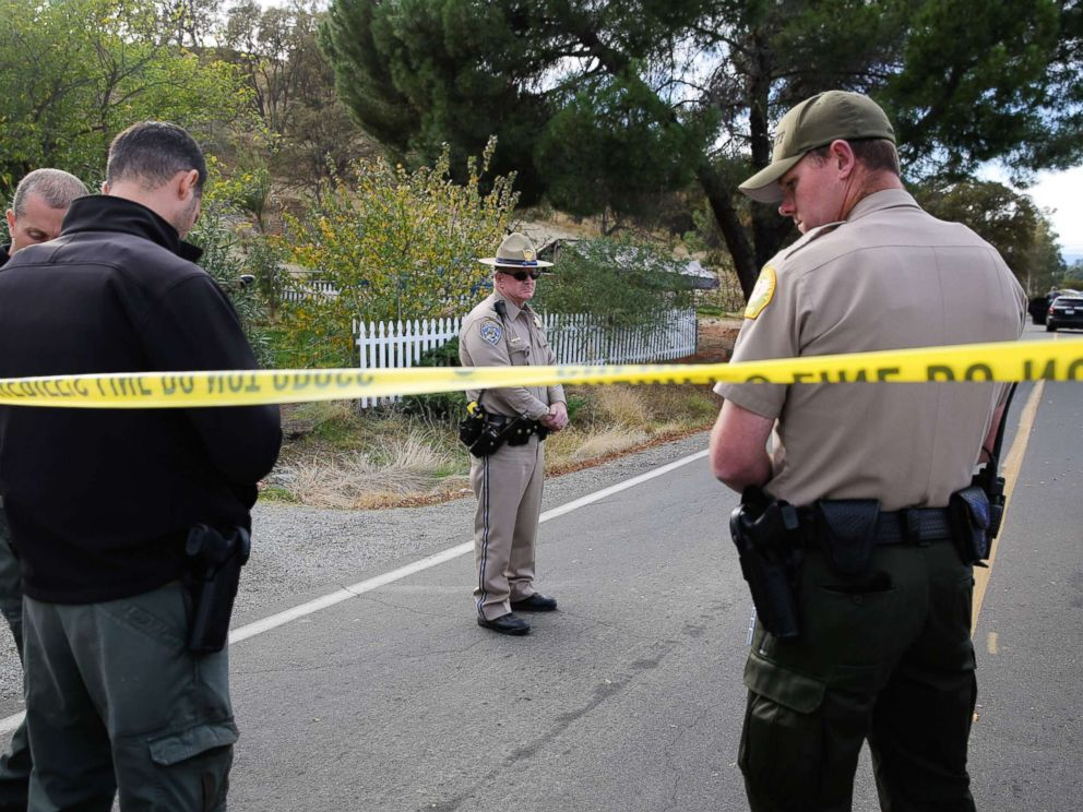 PHOTO: Law enforcement officers stand near one of many crime scenes after a shooting on Nov. 14, 2017, in Rancho Tehama, Calif.