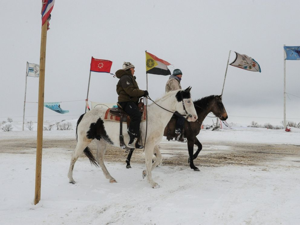 PHOTO: People ride horses in the Oceti Sakowin camp during a protest against plans to pass the Dakota Access pipeline near the Standing Rock Indian Reservation, near Cannon Ball, North Dakota, Nov. 30, 2016.