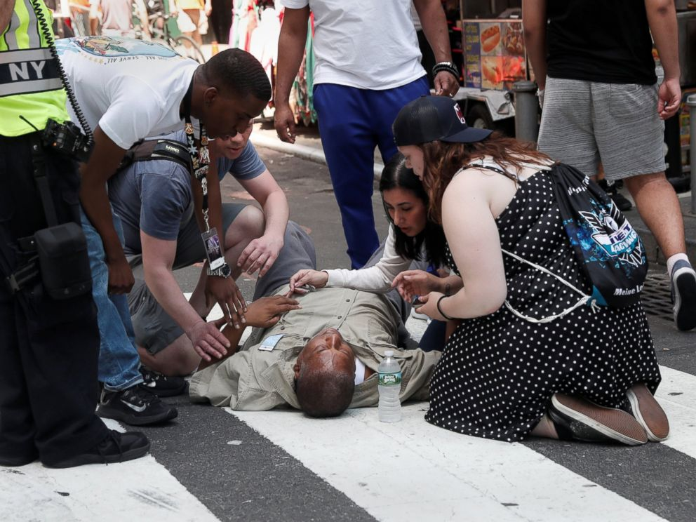 PHOTO: An injured man is helped on the sidewalk in Times Square after a speeding vehicle struck pedestrians on the sidewalk in New York City, May 18, 2017.