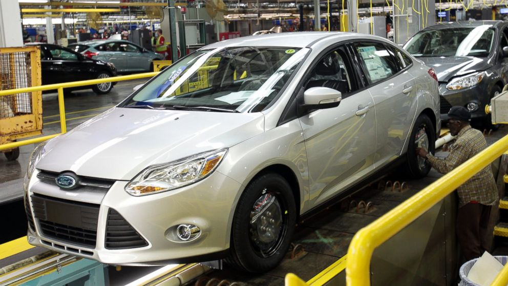 PHOTO: A Ford Motor assembly worker works on the final production line of the 2012 Ford Focus at Michigan Assembly Plant in Wayne, Michigan on March 17, 2011.