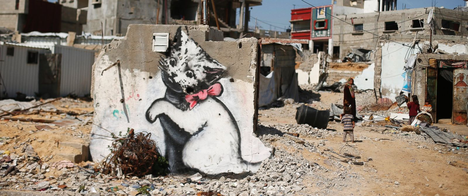 PHOTO: A mural of a playful-looking kitten, presumably painted by British street artist Banksy, is seen on the remains of a house in Beit Hanoun town in the northern Gaza Strip, Feb. 26, 2015.