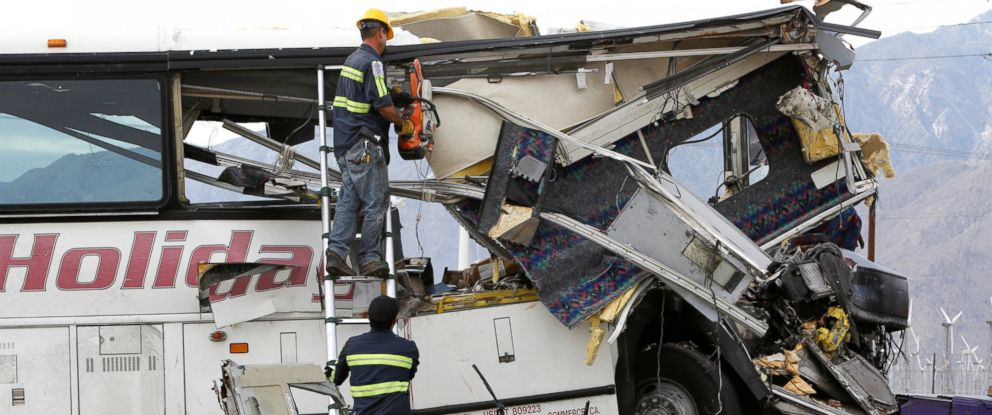 PHOTO: Workers cut away debris from the front of a bus involved in a mass casualty crash on the westbound Interstate 10 freeway near Palm Springs, California, Oct. 23, 2016.