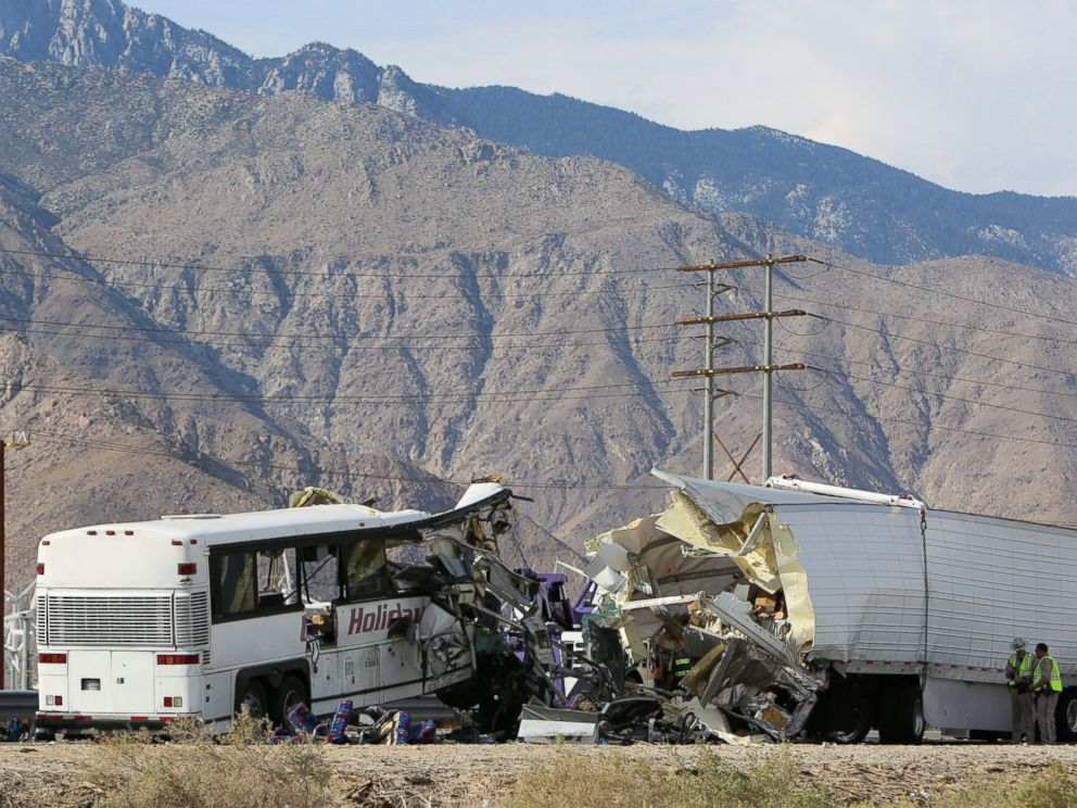 PHOTO: Investigators confer at the scene of a mass casualty bus crash on the westbound Interstate 10 freeway near Palm Springs, California, Oct. 23, 2016.
