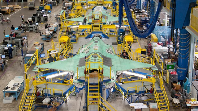 PHOTO: Workers can be seen on the moving line and forward fuselage assembly areas for the F-35 Joint Strike Fighter at Lockheed Martin Corps factory located in Fort Worth, Texas, Oct. 13, 2011.