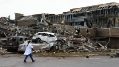 PHOTO: A nurse walks the destruction at Moore hospital after a huge tornado with winds of up to 200 miles per hour (320 kph) struck Moore, Oklahoma, near Oklahoma City, May 20, 2013.