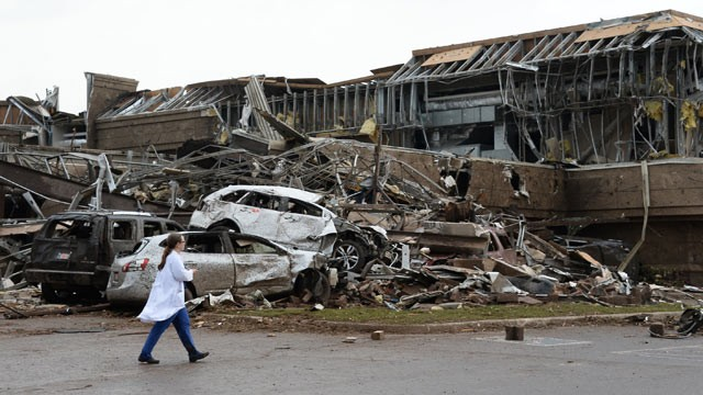 PHOTO: A nurse walks the destruction at Moore hospital after a huge tornado with winds of up to 200 miles per hour struck Moore, Okla., near Oklahoma City, May 20, 2013.