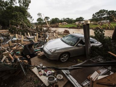 PHOTO: A Porsche rests against the foundation of a home destroyed by the Memorial Day weekend floods in Wimberley, Texas, May 26, 2015.