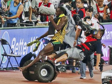 PHOTO: Usain Bolt of Jamaica is hit by a cameraman on a Segway as he celebrates after winning the mens 200 meters final at the 15th IAAF World Championships at the National Stadium in Beijing, China, August 27, 2015.