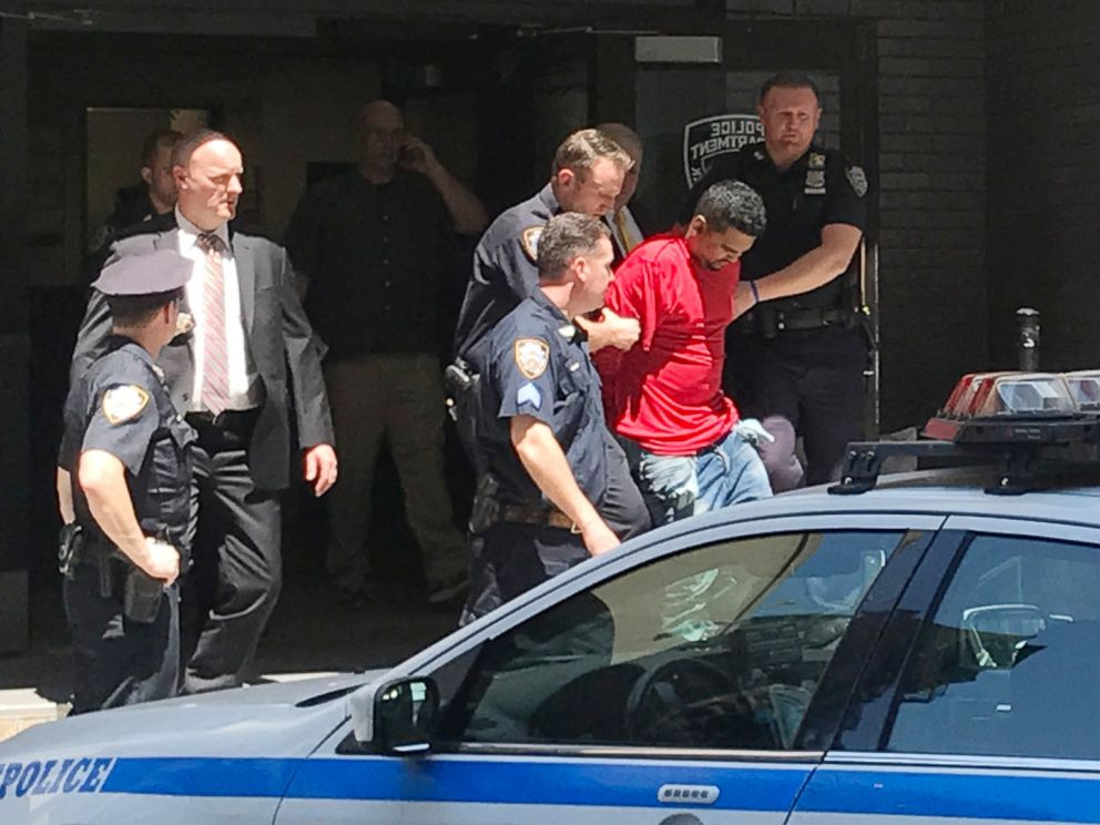 PHOTO: A man, who police said was the suspected driver of a car which crashed into a crowd on Times Square, is led out of the NYPD Midtown South precinct in New York, May 18, 2017.