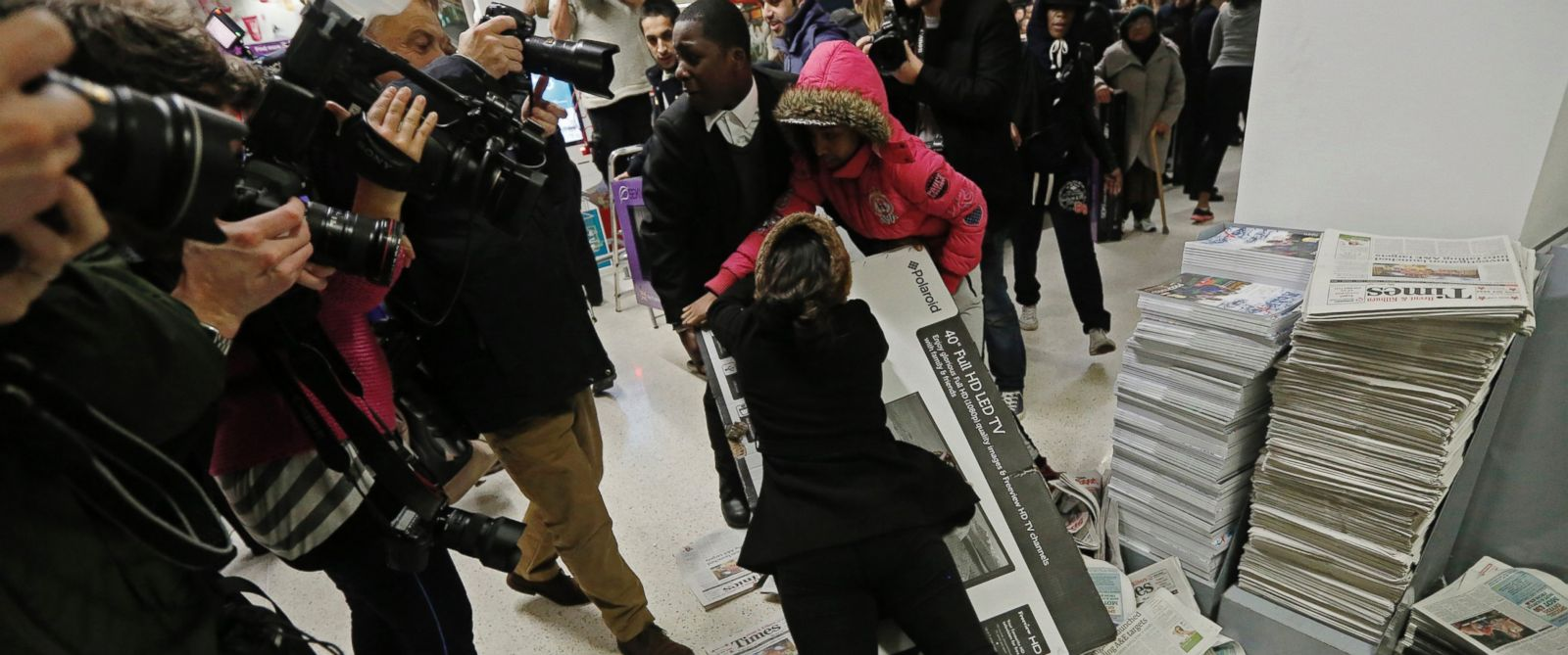 "PHOTO: Shoppers wrestle over a television as they compete to purchase retail items on ""Black Friday"" at an Asda superstore in Wembley, north London November 28, 2014."