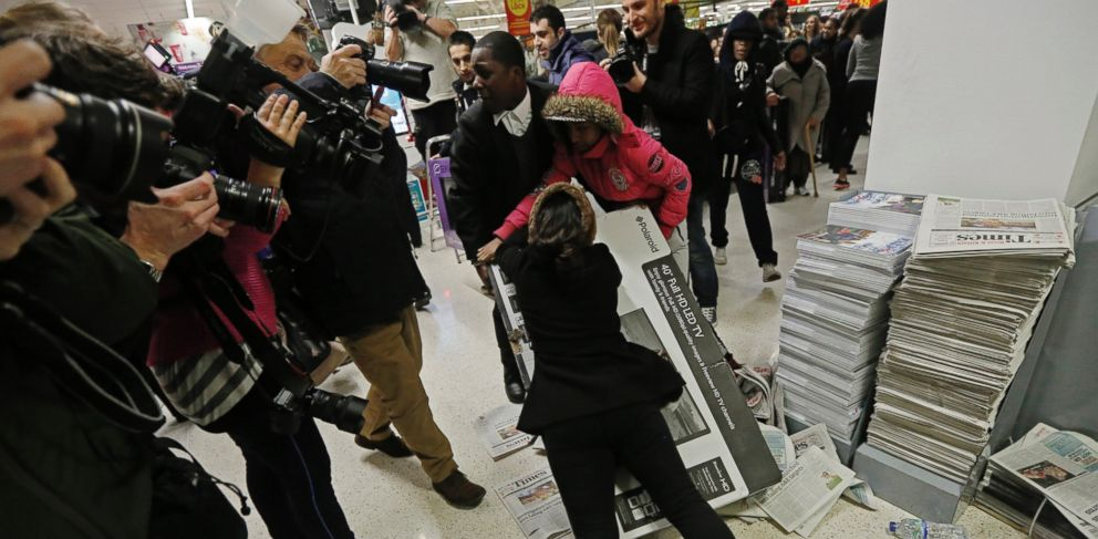 PHOTO: Shoppers wrestle over a television as they compete to purchase retail items on Black Friday at an Asda superstore in Wembley, north London November 28, 2014.