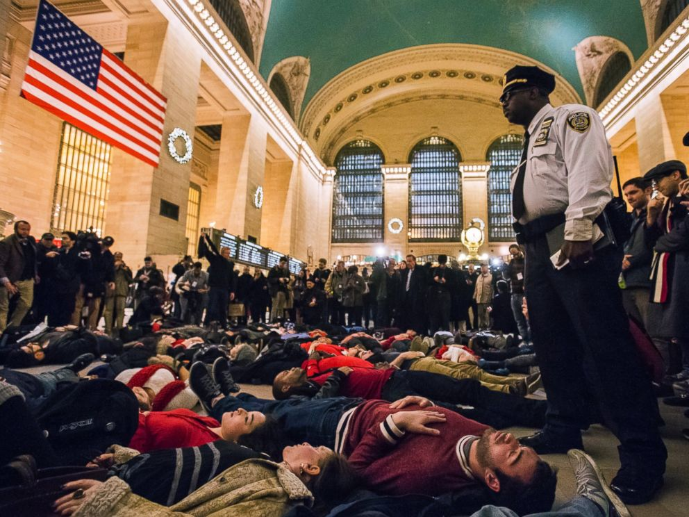 PHOTO: Activists demanding justice for the death of Eric Garner stage a die-in during rush hour at Grand Central Terminal in the Manhattan borough of New York on Dec. 3, 2014.