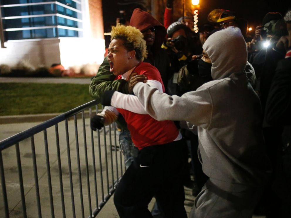PHOTO: A woman approaches the barricade to confront the police outside the Ferguson Police Department in Ferguson, Mo. on Nov. 24, 2014.