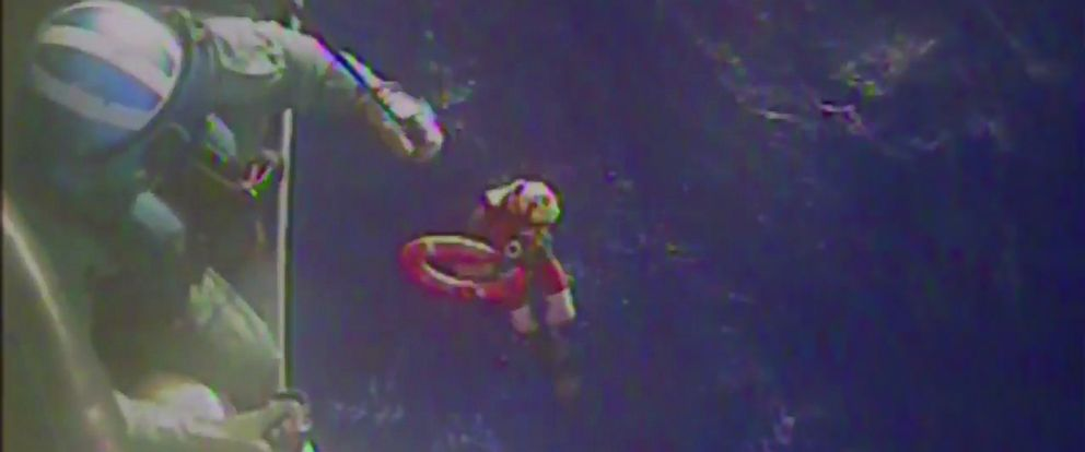 PHOTO: U.S. Coast Guard members retrieve a life preserver ring from the cargo ship El Faro in this still image from an Oct. 4, 2015 U.S. Coast Guard handout video.
