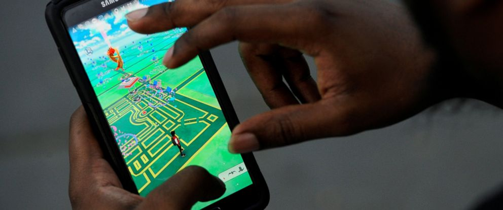 """PHOTO: A virtual map of Bryant Park is displayed on the screen as a man plays the augmented reality mobile game """"Pokemon Go"""" by Nintendo in New York City, July 11, 2016."""