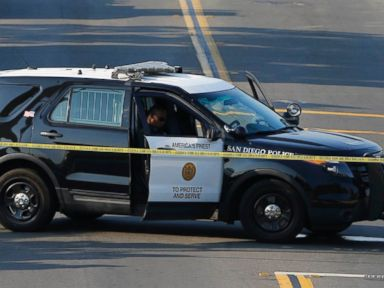 PHOTO: San Diego police officers investigate the scene where an officer was fatally shot and another was injured at a traffic stop late on Thursday, in San Diego, July 29, 2016.