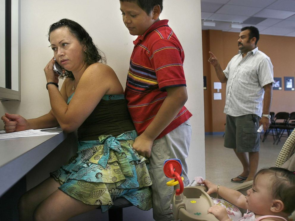 PHOTO: Selma Galindo, with her children Edgar Galindo, and daughter seven-month-old Gabriella Umanzor, apply for TPS, a permit that allows beneficiaries to work and live here legally, at the El Salvador Consulate in Woodbridge, Va., Aug. 24, 2006.