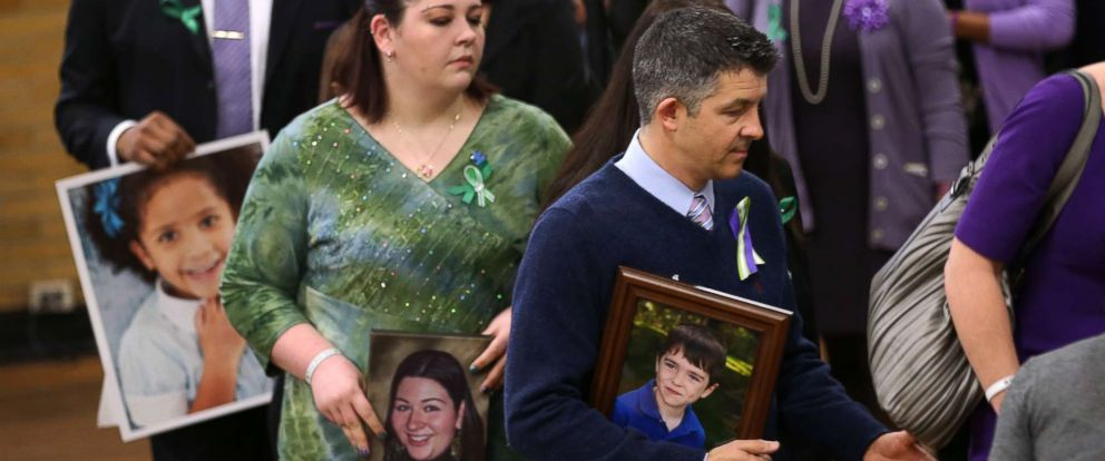 PHOTO: Ian Hockley holds a photo of his son Dylan, 6, during a press conference with other parents of Sandy Hook shooting victims on the one month anniversary of the Newtown elementary school massacre on Jan. 14, 2013 in Newtown, Conn.