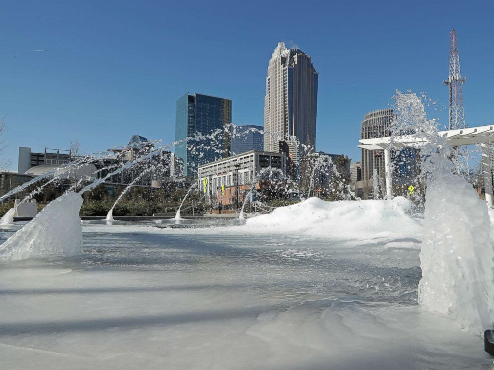 PHOTO: Water squirts from a frozen fountain near downtown in Charlotte, N.C., Jan. 2, 2018.
