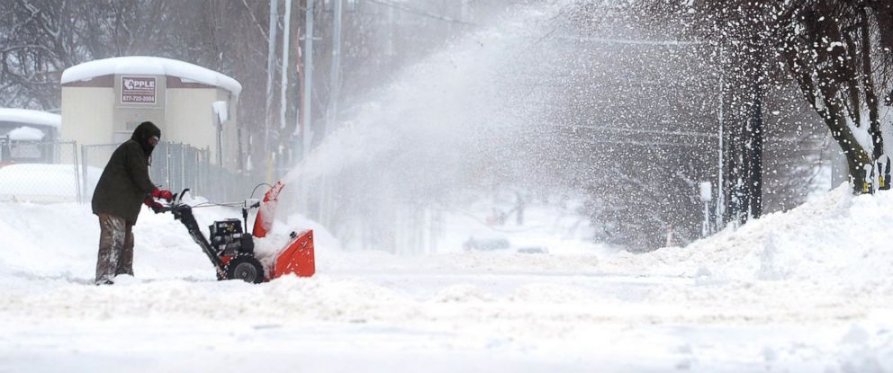 PHOTO: A man clears snow, Dec. 26, 2017, in Erie, Pa. The National Weather Service office in Cleveland says Mondays storm brought 34 inches of snow, an all-time daily snowfall record for Erie.
