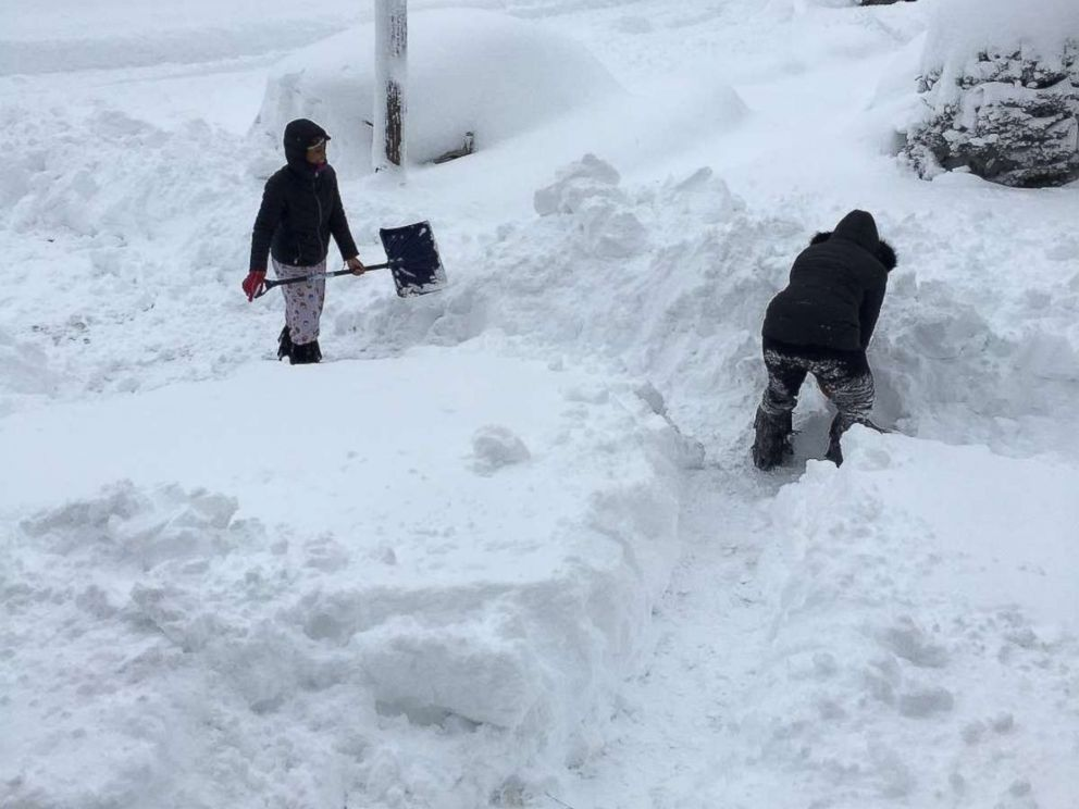 PHOTO: People dig out the path by their house after the record snowfall in Erie, Penn., Dec. 26, 2017, in this picture obtained from social media.
