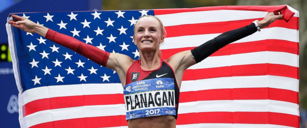 PHOTO: Shalane Flanagan of the United States poses for pictures after crossing the finish line first in the womens division of the New York City Marathon in New York, Nov. 5, 2017.