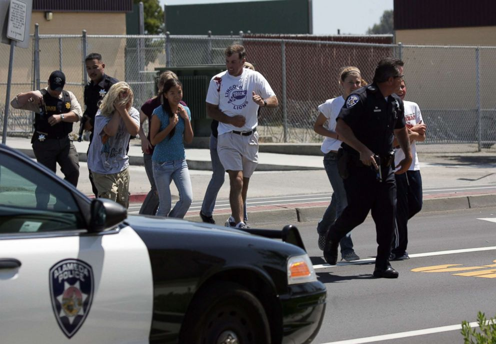 PHOTO: An Alameda Police officer evacuates volunteer students wearing makeup to simulate injuries during a school shooting and mass evacuation drill at Lincoln Middle School, May 22, 2007, in Alameda, Calif.