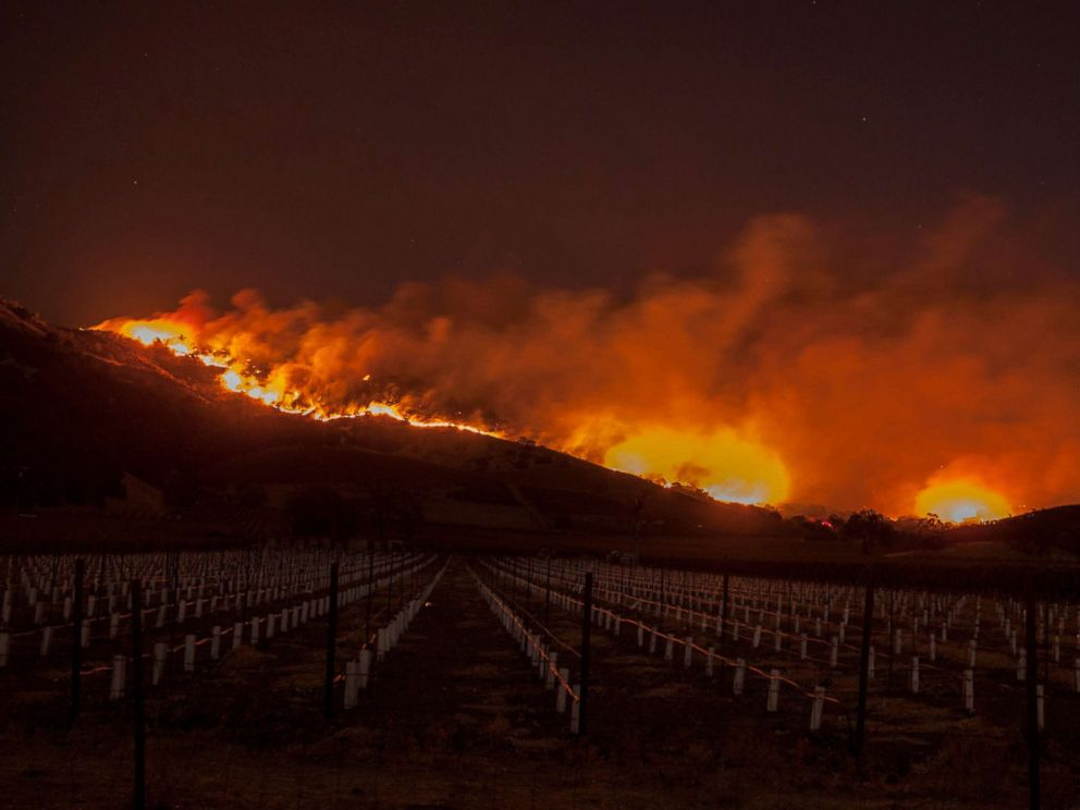 PHOTO: Flames moved through the hills above the Silverado Trail as a wildfire raged through the Napa/Sonoma wine region, Oct. 9, 2017.