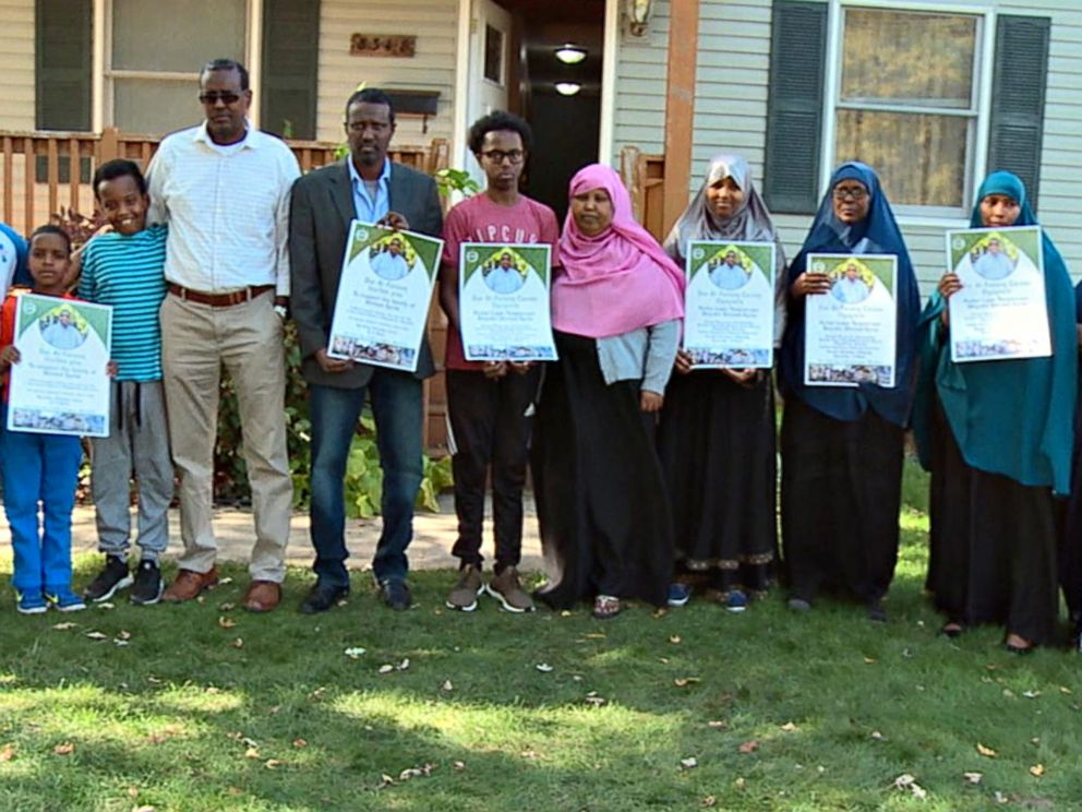 PHOTO: The grieving extended family of Ahmed Abdikarin Eyow, who was killed in a terrorist attack in Mogadishu, Somalia on Oct. 14, 2017, hold signs for a fundraiser in his memory.