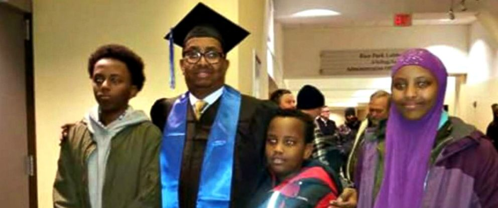 PHOTO: Ahmed Abdikarin Eyow, shown here in a graduation gown with his three children Yonis, Yahya and Yusra, was passionate about education.