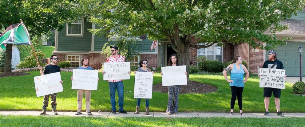 PHOTO: Protesters stand outside the family home of Brock Turner in Sugarcreek Township, Ohio, Sept. 3, 2016.