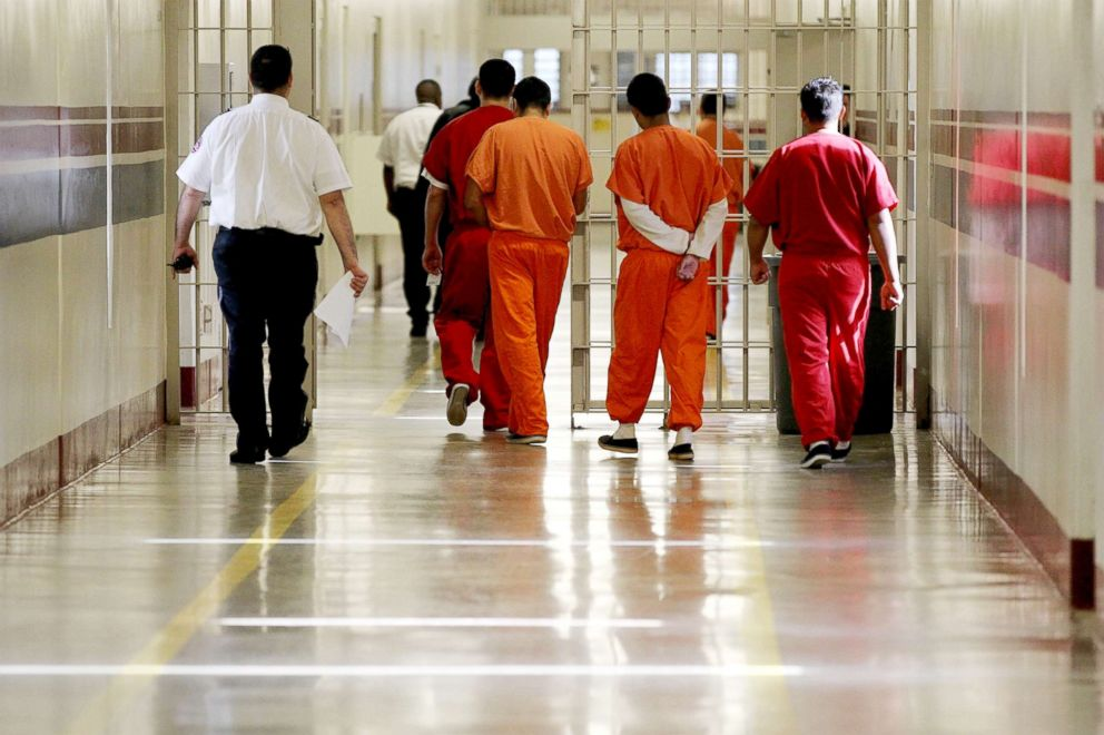 PHOTO: Detainees at the Stewart Detention Center in Lumpkin, Ga. are escorted through a corridor on May 03, 2012.