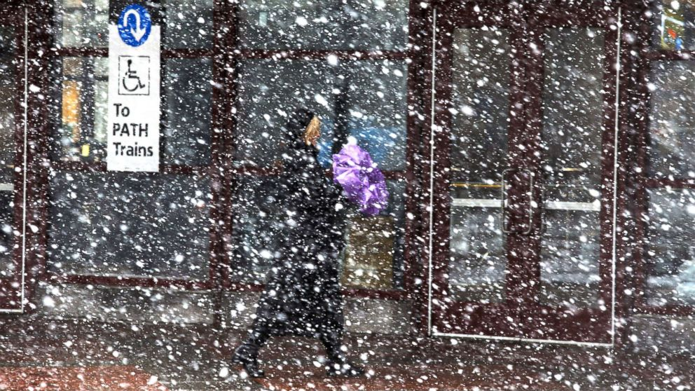 Nor'easter by the numbers: The latest on snow totals, power outages, flight cancellations and more