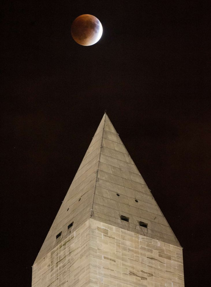 PHOTO: A perigee full moon, or supermoon, is seen behind the Washington Monument during a total lunar eclipse on Sept. 27, 2015, in Washington.