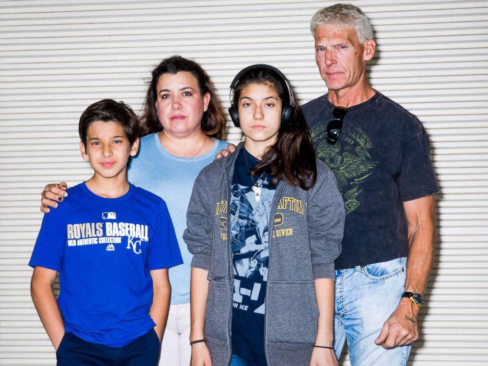 PHOTO: Oliver Montagner, Gladis Gutierrez, Jamely Montagner and John Salmon have their family photo taken during the expo.
