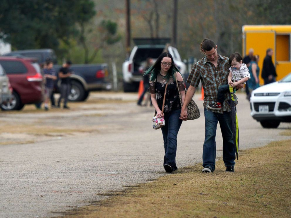 PHOTO: A family leaves the First Baptist Church of Sutherland Springs worship service, the first service since a gunman opened fire inside the small church a week earlier in Sutherland Springs, Texas, Nov. 12, 2017.