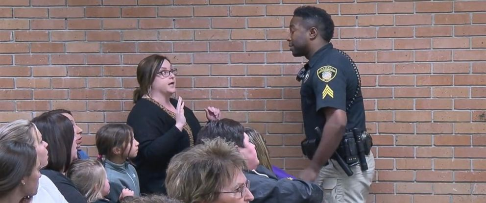 PHOTO: A video obtained by KATC shows teacher, Deyshia Hargrave, being handcuffed and removed from a school board meeting at Vermilion Parish in Louisiana.