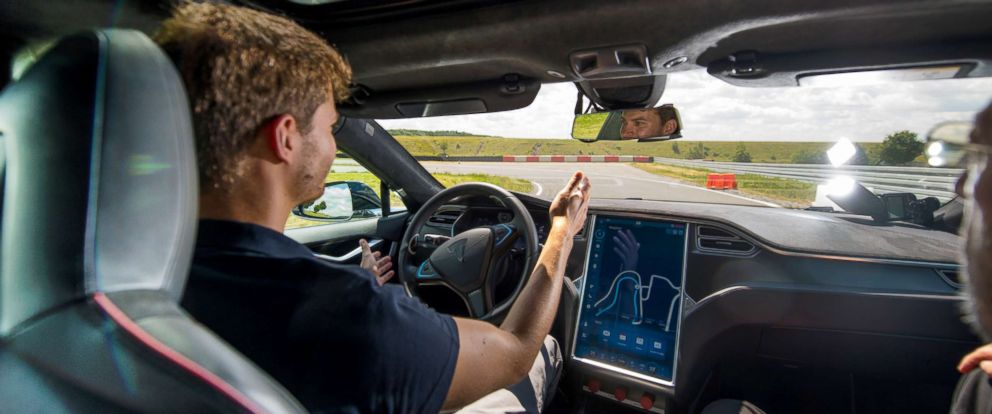 PHOTO: A test driver removes his hands from the steering wheel of a Tesla Model S electric automobile fitted with self driving technology, July 4, 2017.
