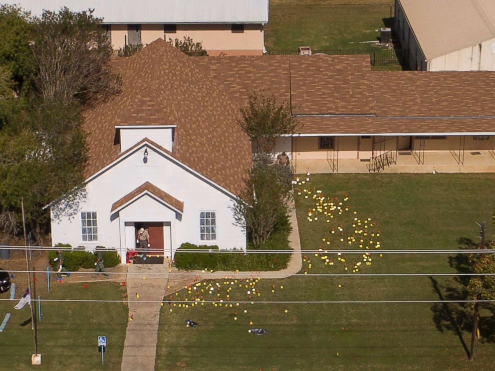 PHOTO: Flags mark evidence on the lawn of the First Baptist Church in Sutherland Springs, Texas, Nov. 6, 2017, a day after the mass shooting.